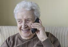 Happy senior woman on phone Stock Image