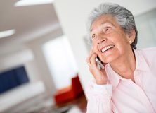 Happy senior woman on the phone Royalty Free Stock Photos
