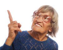 Happy senior woman pointing upwards Royalty Free Stock Photography