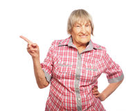 Happy senior woman pointing upwards Stock Images