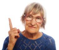Happy senior woman pointing upwards Royalty Free Stock Photo