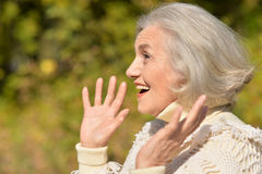 Happy senior woman. Portrait of a happy senior woman outdoors stock photography