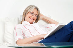 Happy senior woman reading Stock Photography