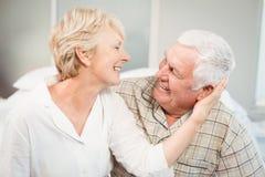 Happy senior woman romancing with husband Royalty Free Stock Photo