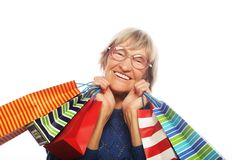 Happy senior woman with shopping bags Royalty Free Stock Image