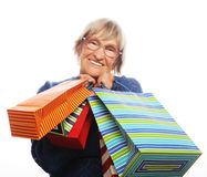 Happy senior woman with shopping bags Stock Image
