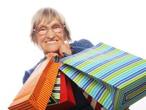 Happy senior woman with shopping bags Royalty Free Stock Photography