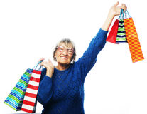 Happy senior woman with shopping bags Stock Photo