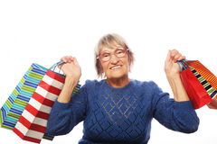 Happy senior woman with shopping bags Royalty Free Stock Photo