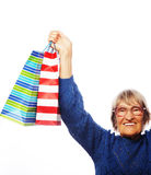 Happy senior woman with shopping bags Stock Photos