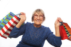 Happy senior woman with shopping bags Royalty Free Stock Images