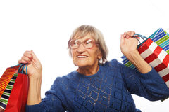 Happy senior woman with shopping bags Stock Photography