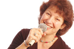 Happy senior woman singing Microphone in hand  Royalty Free Stock Photos