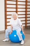 Happy Senior Woman Sitting On Fitness Ball Stock Photos