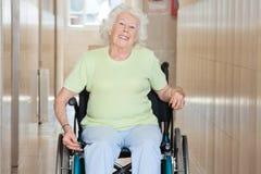 Happy Senior Woman Sitting In a Wheel Chair Stock Photos
