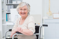 Happy senior woman sitting on wheelchair Royalty Free Stock Image