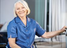 Happy Senior Woman Sitting On Wheelchair Stock Photos