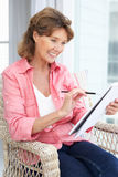 Happy senior woman sketching Stock Images