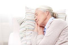 Happy senior woman sleeping on pillow at home Royalty Free Stock Photography