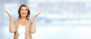 Happy senior woman. Happy smiling senior woman over blue background royalty free stock image