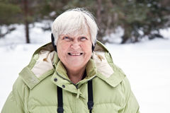 Happy Senior Woman in The Snow Stock Images