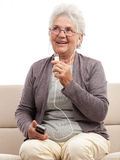 Happy senior woman talking at cellphone microphone Stock Photo