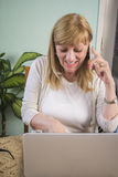 Happy senior woman talking over her phone Stock Images