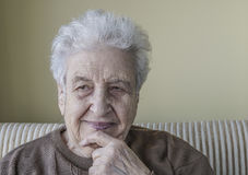 Happy senior woman thinking. A happy senior woman thinking royalty free stock photography