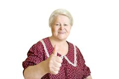 Happy senior woman with thumb up Stock Photo