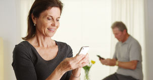 Happy senior woman using smartphone Stock Photo
