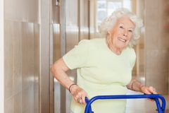 Happy Senior Woman Using Zimmer Frame Royalty Free Stock Photography