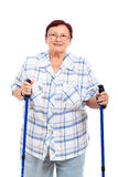 Happy senior woman with walking sticks Stock Photography