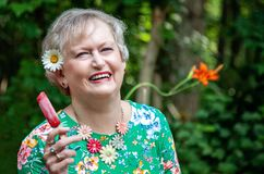 Free Happy Senior Woman With Popsicle During Summer Stock Image - 189598891