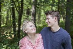 Happy senior woman and young man. Faces of smiling, happy grandmother and grandson hugging royalty free stock images