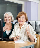 Happy Senior Women At Computer Desk In Classroom. Portrait of happy senior women at computer desk in classroom Royalty Free Stock Photo