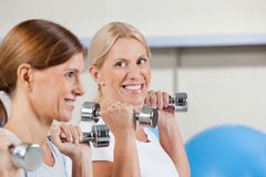 Happy senior women exercising Stock Image