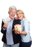 Happy senior women with money Stock Photography