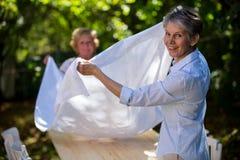 Happy Senior Women Preparing Picnic Table Royalty Free Stock Photography