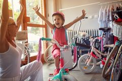 Senior woman shopping new bicycle for little girl. Happy senior women shopping new bicycle for little girl royalty free stock image