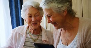 Happy senior women using digital tablet 4k. Happy senior women using digital tablet in retirement home 4k stock footage