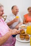 Happy seniors. Friends having breakfast together royalty free stock photos