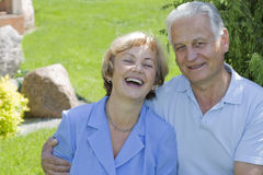 Happy seniors - 42 years in love. Smiling senior couple in their backyard royalty free stock image