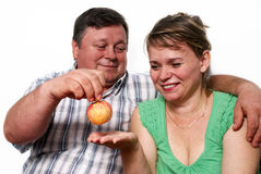 Happy seniors couple with apple Stock Photography