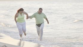 Happy seniors couple  on beach Royalty Free Stock Photography