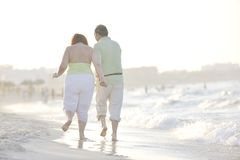 Happy seniors couple on beach stock images