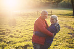 Happy seniors couple embrace and smile; Royalty Free Stock Photo