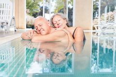 Senior couple is sleeping peacefully in the pool. Happy seniors couple is sleeping peacefully in the pool during a wellness vacation royalty free stock images