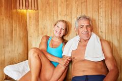 Senior couple on vacation in the sauna. Happy seniors couple together in wellness vacation in the sauna stock images