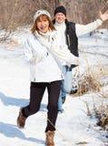 Happy seniors couple in winter park. Elderly mature people stock images