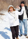 Happy seniors couple in winter park Royalty Free Stock Photo